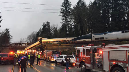 Mangled locomotive, last piece of Amtrak train wreckage, removed from Washington freeway