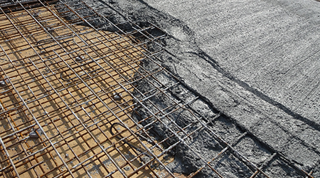 The wet concrete poured on a steel reinforcement bar to form strong floor slabs called reinforce concrete floor slab.