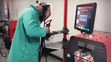 A man using a virtual welding machine